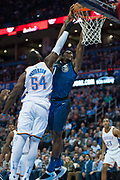 OKLAHOMA CITY, OK - FEBRUARY 26: Orlando Magic Center Bismack Biyombo (11) going up to dunk the ball while Oklahoma City Thunder Center Patrick Patterson (54) plays defense at Chesapeake Energy Arena Oklahoma City, OK (Photo by Torrey Purvey/Icon Sportswire)