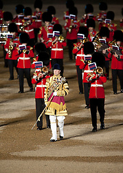 © Licensed to London News Pictures. LONDON, UK  09/06/11. The massed bands of the Guards Brigade follow a bandmaster during the annual Beating of the Retreat at Horse Guards Parade. On two successive evenings each year in June a pageant of military music, precision drill and colour takes place on Horse Guards Parade in the heart of London when the Massed Bands of the Household Division carry out the Ceremony of Beating Retreat. 300 musicians, drummers and pipers perform this age-old ceremony. The Retreat has origins in the early days of chivalry when beating or sounding retreat pulled a halt to the days fighting. Please see special instructions. Photo credit should read Matt Cetti Roberts/LNP. Please see special instructions for usage rates. Photo credit should read Matt Cetti-Roberts/LNP
