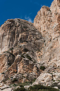 Climbing walls of Natural Park of Penon de Ifach, situated in Calp village, a massive limestone rock emerging from the sea and linked to the shore by rock debris, Calpe, Costa Blanca, Alicante province,Spain