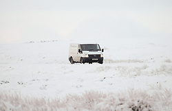 © Licensed to London News Pictures. <br /> 27/12/2014. <br /> <br /> Castleton, United Kingdom.<br /> <br /> Drivers make their way cautiously over the snow covered roads of the North Yorkshire Moors near Castleton after overnight snowfall caused disruption in some parts of the country.<br /> <br /> Photo credit : Ian Forsyth/LNP