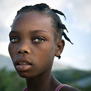 Jenny Duqai, 12, outside her home in Gros-Morne.