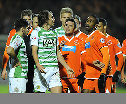 Blackpool's Ricardo Fuller remonstrates with Yeovil Town's Luke Ayling  after Fullers head butt on Aylinf resulted in a red card for Fuller - Photo mandatory by-line: Joe Meredith/JMP - Tel: Mobile: 07966 386802 03/12/2013 - SPORT - Football - Yeovil - Huish Park - Yeovil Town v Blackpool - Sky Bet Championship