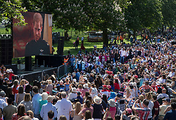 © Licensed to London News Pictures. 19/05/2018. Windsor, UK. Crowds watch the wedding of The Duke and Duchess of Sussex on a giant screen on The Long Walk, Windsor. Photo credit: Peter Macdiarmid/LNP