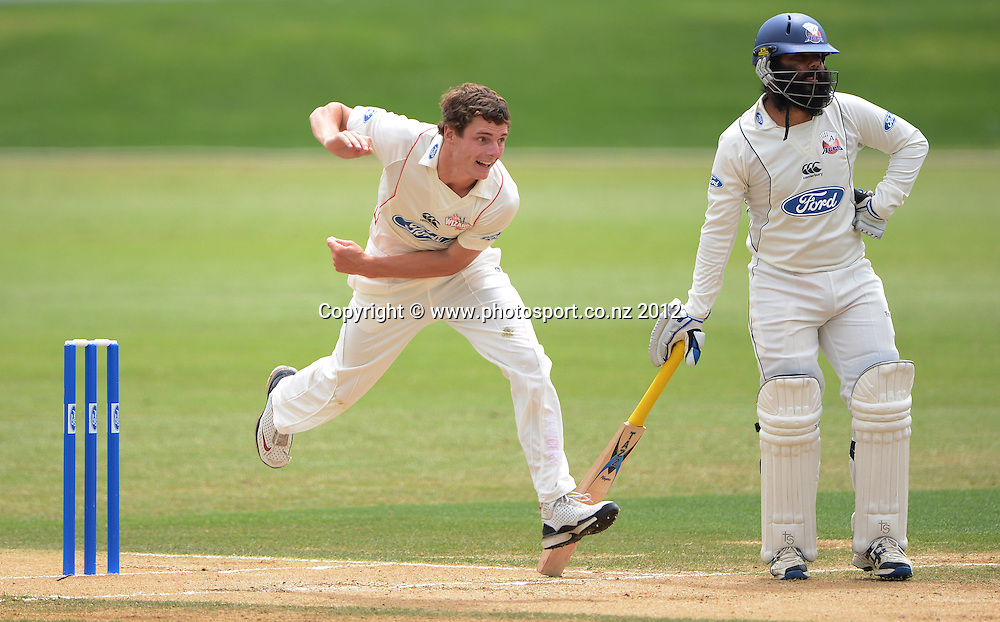 Edward Nuttall bowling for Canterbury. Plunket Shield Cricket, Auckland Aces v Canterbury Wizards at Eden Park Outer Oval. Auckland on Tuesday 18 December 2012. Photo: Andrew Cornaga/Photosport.co.nz