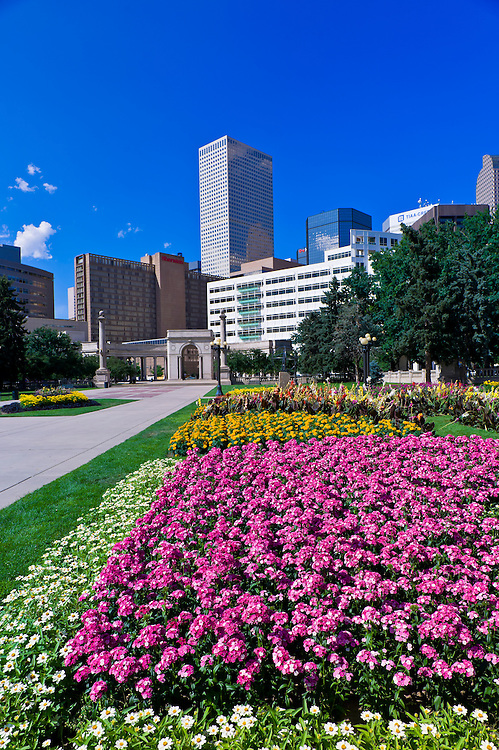 Flower gardens in Civic Center Park with Downtown Denver in  background, Denver, Colorado USA