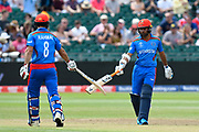 Rahmat Shah of Afghanistan and Hashmatullah Shahidi of Afghanistan touch bats during the ICC Cricket World Cup 2019 match between Afghanistan and Australia at the Bristol County Ground, Bristol, United Kingdom on 1 June 2019.