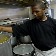 Volunteers preparing food for Thanksgiving for the homeless a week in advance.<br />