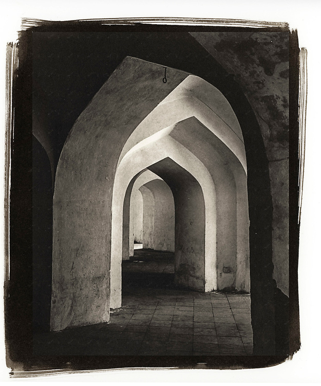 A passageway underneath the Man Singh Palace in the Amber Fort near Jaipur, India shows the architectural detail of the Islamic-style architecture.
