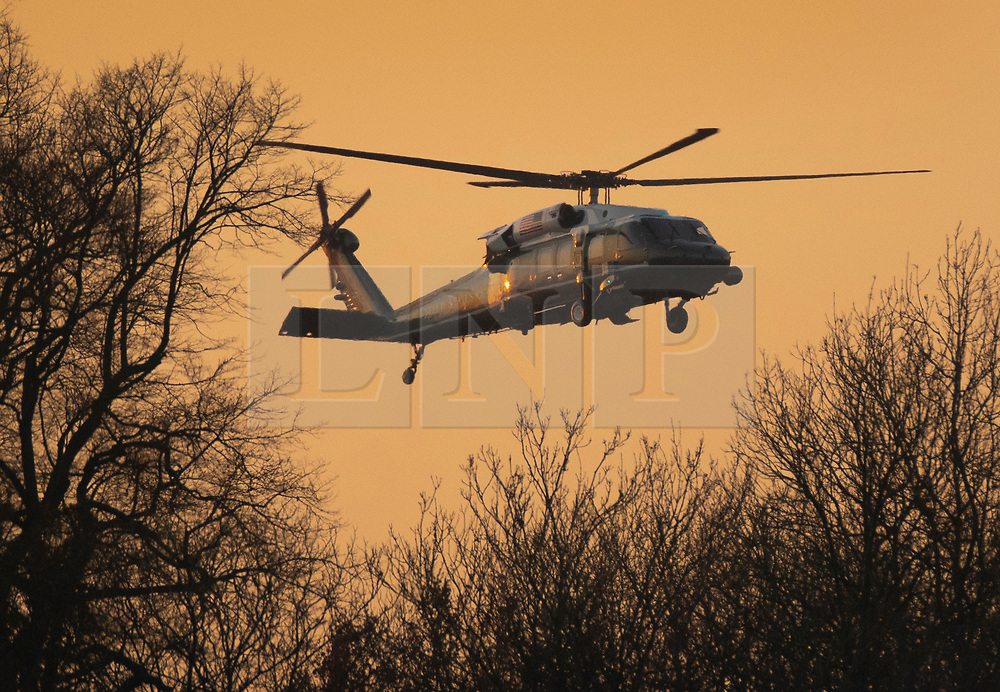 © Licensed to London News Pictures. 04/12/2019. Watford, UK. A US Marine One Helicopter arrives to collect US President Trump from The Grove Hotel after he cancelled his post NATO summit press conference. World leaders have finished attending a series of events over the two day NATO summit which marked the 70th anniversary of the alliance of nations. Photo credit: Peter Macdiarmid/LNP