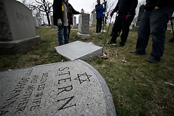 People assess the damage after hundreds of headstones got vandalized at Mt. Carmel Jewish Cemetery in Northwest Philadelphia, PA, on Feb. 27, 2017. Over the weekend hundreds of headstones were vandalized.