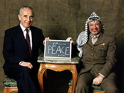 SHIMON PERES (2 August 1923 - 28 September 2016) was a Polish-born Israeli statesman. Born Szymon Perski, he was the ninth President of Israel from 2007 to 2014, served twice as the Prime Minister of Israel and twice as Interim Prime Minister, and he was a member of 12 cabinets in a political career spanning over 66 years. Peres won the 1994 Nobel Peace Prize together with Yitzhak Rabin and Yasser Arafat for the peace talks that he participated in as Israeli Foreign Minister, producing the Oslo Accords. PICTURED: Dec 1994 - Stockholm, Sweden - Foreign Minister of Israel SHIMON PERES (L) & Leader of the PLO YASSER ARAFAT hold a blackboard between them with PEACE written by the two in English & Arabic during a photosession at the Grand Hotel. Peres and Arafat received the Nobel Peace prize in Oslo two days earlier. (Credit Image: © Claes Lofgren/Pressens Bild/ZUMAPRESS.com)
