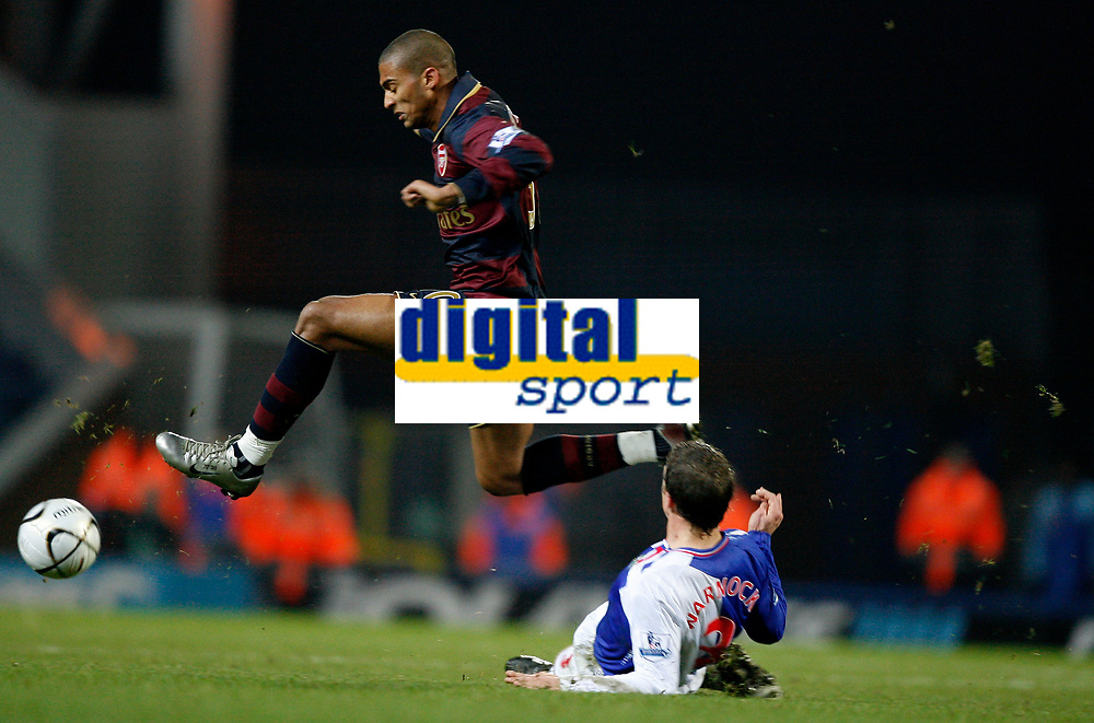 Photo: Paul Greenwood/Sportsbeat Images.<br />Blackburn Rovers v Arsenal. Carling Cup, Quarter Final. 18/12/2007.<br />Arsenal's Armand Traore leaps the tackle of Blackburn's Stephen Warnock