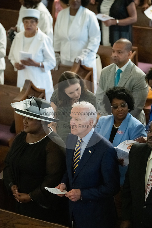 Democratic presidential hopeful former Vice President Joe Biden joins in singing a hymn during Sunday service at the Morris Brown AME Church July 7, 2019 in Charleston, South Carolina. South Carolina, called the First in the South, is the first southern democratic primary in the presidential nomination race.