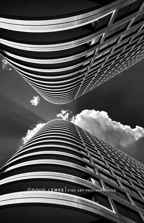 Skyscraper symmetry, Clouds and sunburst overhead