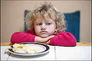 .3-year-old Ava Garrett pouts while eating lunch at home on Thursday afternoon, October 12, 2006.