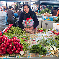 TIMISOARA, ROMANIA - APRIL 21:  A vegetable seller poses in front of her  stall at the daily market on April 21, 2013 in Timisoara, Romania.  Romania has abandoned a target deadline of 2015 to switch to the single European currency and will now submit to the European Commission a programme on progress towards the adoption of the Euro, which for the first time will not have a target date. (Photo by Marco Secchi/Getty Images)