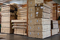 Stacks of plywood piled up in warehouse