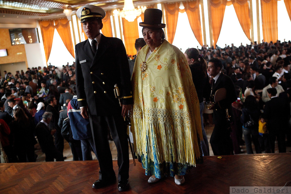 A Bolivian Navy officer, left poses for a picture with his mother, an Aymara indigenous woman, as they attend a graduation ceremony in La Paz, Thursday, Dec. 10, 2009. (Photo Dado Galdieri)