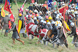 © Licensed to London News Pictures. 13/10/2018<br /> BATTLE, UK.<br /> Norman army march to battle.<br /> English Heritage Battle of Hastings re-enactment at Battle Abbey,Battle, on the 1066 battle field.<br /> Photo credit: Grant Falvey/LNP