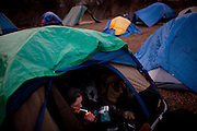 Peggysue Peterson relaxes in her tent at the SafeGround camp in Sacramento, Calif., January 13, 2011.