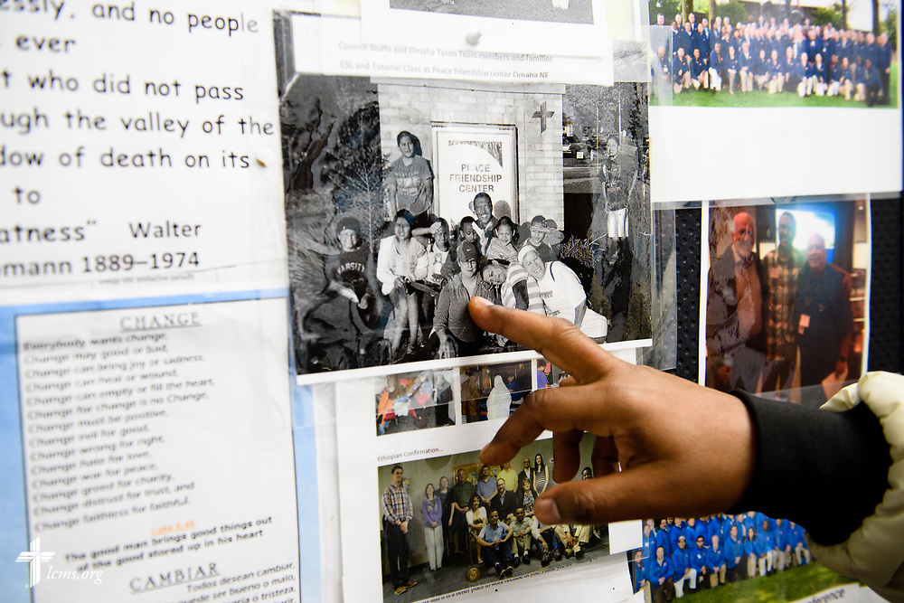 The Rev. Eddie Mekasha, chaplain at Tyson Foods, points to his outside work at the Peace International Friendship Center, a ministry of Beautiful Savior Lutheran Church, LaVista, Neb., on Wednesday, June 7, 2017, in Council Bluffs, Iowa. LCMS Communications/Erik M. Lunsford
