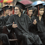 Mamaroneck, NY / 2009 - Seniors react while sitting through a heavy rain during the Mamaroneck High School graduation June 23. ( Mike Roy / The Journal News )