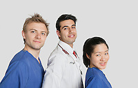 Portrait of multi ethnic medical team over gray background