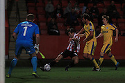 Ryan jennings and Ian Sharps during the Vanarama National League match between Cheltenham Town and Chester City at Whaddon Road, Cheltenham, England on 5 December 2015. Photo by Antony Thompson.