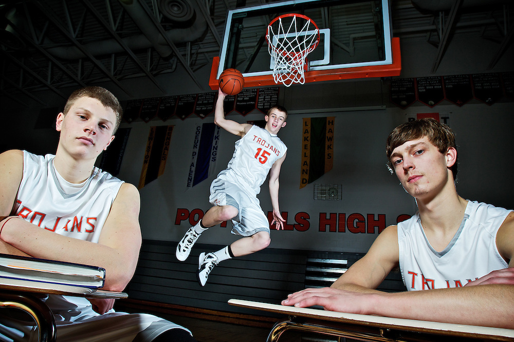 Michael Hillman, left, Luke Thoreson, and Seth Anderson grew up playing basketball together and all three have excelled academically at Post Falls High. The trio will travel to the Idaho Center in Nampa with their team Thursday to begin their quest for a 5A state championship title.