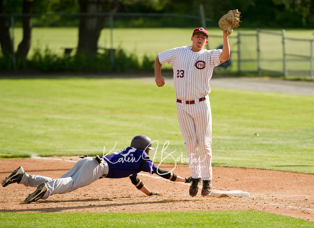 Concord's first baseman Dillon Emerson goes up for the catch to allow Nashua South's Nick Reed safety back to the bag during Division I baseball first round tournament action Thursday afternoon.  (Karen Bobotas/for the Concord Monitor)
