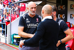 Former Rotherham United player and current Lincoln City goalkeeping coach Andy Warrington shakes hands with former teammate and current Rotherham United manager Paul Warne - Mandatory by-line: Ryan Crockett/JMP - 10/08/2019 - FOOTBALL - Aesseal New York Stadium - Rotherham, England - Rotherham United v Lincoln City - Sky Bet League One