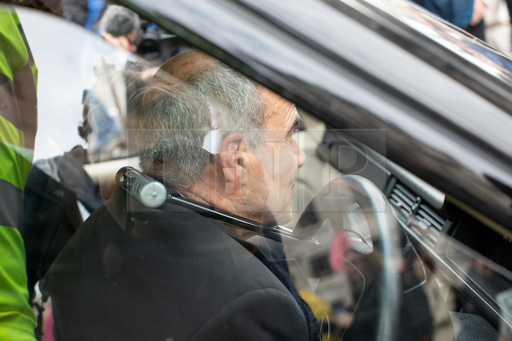 © Licensed to London News Pictures. 07/10/2019. London, UK. A climate change activist locks himself to a hearse blocking the road in Trafalgar Square, London, closing the road to traffic, as part of a wider two week long demonstration to cause disruption in the capital. The activists are calling for the government to acknowledge and act on climate change. Photo credit : Tom Nicholson/LNP