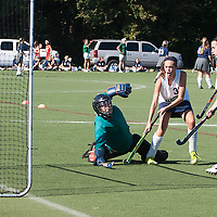 6 SEP 2010 -- FENTON, Mo. -- Marquette High School  field hockey player, Suzanne Sterns (38) beats Nerinx Hall Academy Green goalkeeper to tie the game  during the Gateway Field Hockey Labor Day Tournament at the A-B Center in Fenton, Mo., Monday Sept. 6, 2010.  The match ended tied 2-2.
