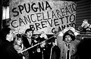 """Militants of La Rete (The Net political party) demonstrate against a new law to depenalize the unlawful financing of political parties near the frontdoor of Bettino Craxi office at Duomo square in Milan, March 8, 1993. The law - called pass the sponge - was introduced by Giovanni Conso, Minister of Justice of Giuliano Amato cabinet. Demonstrators hold a big sponge that reads """"Sponge deletes crime, patent G. Amato""""...Militanti de La Rete manifestano contro il decreto legge di depenalizzazione del finanziamento illecito dei partiti - detta colpo di spugna - davanti allo studio di Craxi in piazza del Duomo a Milano, 8 marzo 1993. Il decreto legge é stata proposta dal ministro della giustizia Giovanni Conso del governo Amato."""