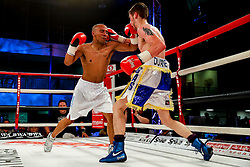 Bristol Rovers fan Duane Winters (aka The Gasman, blue and white shorts) on his way to a points victory over Darren Pryce (white shorts) in a Super Bantamweight bout on the undercard - Photo mandatory by-line: Rogan Thomson/JMP - 07966 386802 - 13/06/2015 - SPORT - BOXING - Bristol, England - Action Indoor Sports Arena - Lee Haskins vs Ryosuke Iwasa - Interim IBF World Bantamweight Title Fight - UNDERCARD.
