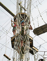 Jacob Pfister maneuvers through a sea of ropes at the Monkey Trunks Rope course with fellow students from Newfound Bridge Academy on Thursday morning.  (Karen Bobotas/for the Laconia Daily Sun)