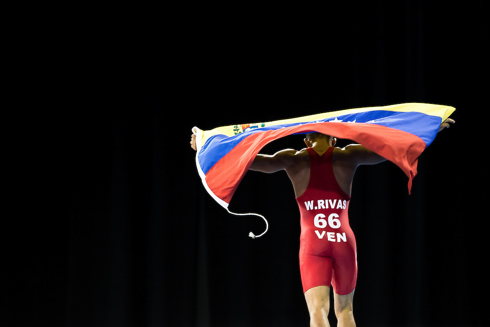 Wuileixis Rivas (R) of Venezuela celebrates his Gold medal win over Bryce Saddoris of the United States in the 66kg class of the men's greco-roman wrestling at the 2015 Pan American Games in Toronto, Canada, July 15,  2015.  AFP PHOTO/GEOFF ROBINS
