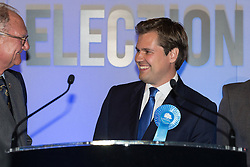 © Licensed to London News Pictures . 06/06/2014 . Newark , Nottinghamshire , UK . Conservative candidate and winner Robert Jenrick steps forward to read his acceptance speech . The count for the Newark by-election at Kelham Hall , Newark , this morning (Friday 6th June 2014) . Photo credit : Joel Goodman/LNP