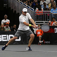 Tennis pro Andy Roddick returns the ball as he plays during the PowerShares Tennis Series event at the Amway Center on January 5, 2017 in Orlando, Florida. (Alex Menendez via AP)
