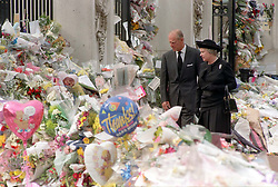 The Queen and the Duke of Edinburgh view the floral tributes to Diana, Princess of Wales, at Buckingham Palace.