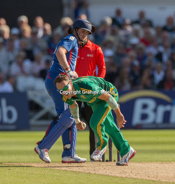 Faf du Plessis catches Alastair Cook off his own bowling during the fifth and final NatWest Series one day international between England and South Africa at Trent Bridge, Nottingham. Photo: Graham Morris (Tel: +44(0)20 8969 4192 Email: sales@cricketpix.com) 05/09/12