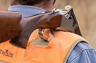 Many miles were required to wear a hole like this in John Zeman's bird hunting vest.