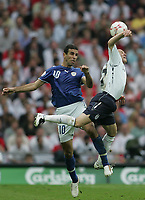 Photo: Lee Earle.<br /> England v Israel. UEFA European Championships Qualifying. 08/09/2007.England's Andy Johnson (R) clashes with Valeed Badeer.