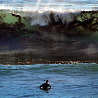 A kelp-filled wave zeroes in on a surfer in the lineup off of 34th Avenue late Tuesday afternoon as a west-northwest ground swell poured into local breaks with a -0.9 low tide exposing the kelp beds and sea grass late in the day. (Shmuel Thaler/Sentinel)