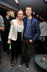 STELLA McCARTNEY and RYAN McGINLEY at a dinner in honour of artist Ryan McGinley hosted by Alison Jacques to mark the occasion of his UK debut show 'Moonmilk' held at Paramount, Level 31, Centre Point, 103 New Oxford Street, London WC1 on 10th September 2009.