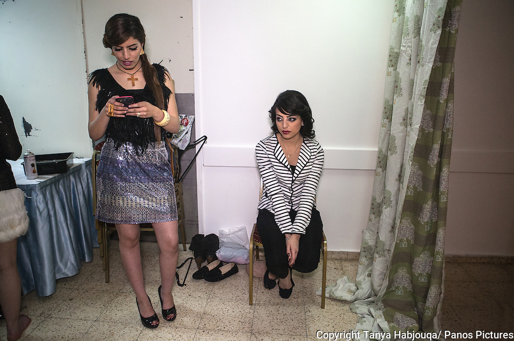 First time models relax backstage at Palestinian designer Nadya Hazboun's fashion show in Bethlehem.