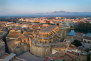 Chevet of the Cathedral of St Mary, aerial view, built 1347-1757, with the river Ebro behind, in Tortosa, Catalonia, Spain. The building was designed by Benito Dalguayre in Catalan Gothic style and has an 18th century Baroque facade. The site previously housed a Romanesque church, a mosque and a Roman forum. Picture by Manuel Cohen