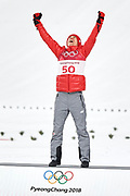 South Korea, PyeongChang - 2018 February 17: Kamil Stoch from Poland celebrates his olympic gold medal while flower ceremony after Men's Large Hill Individual Final during The 2018 PyeongChang Olympic Winter Games at Alpensia Ski Jumping Centre on February 17, 2018 in PyeongChang, South Korea.<br /> <br /> Mandatory credit:<br /> Photo by &copy; Adam Nurkiewicz<br /> <br /> Adam Nurkiewicz declares that he has no rights to the image of people at the photographs of his authorship.<br /> <br /> Picture also available in RAW (NEF) or TIFF format on special request.<br /> <br /> Any editorial, commercial or promotional use requires written permission from the author of image.