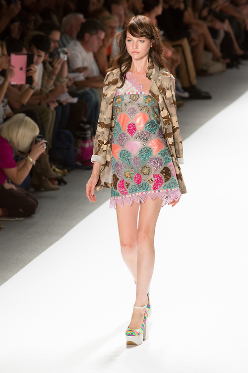One shoulder dress with beads and sequins, and print jacket. By Custo Barcelona at the Spring 2013 Fashion Week show in New York.