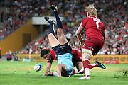 Luke Burgess gets up ended by Anthony Faingaa. Queensland Reds v NSW Waratahs. Investec Super Rugby Round 10 Match, 24 April 2011. Suncorp Stadium, Brisbane, Australia. Reds won 19-15. Photo: Clay Cross / photosport.co.nz